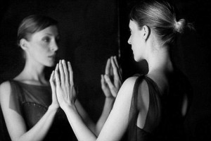 Woman Looking at Reflection --- Image by © Elisa Lazo de Valdez/Corbis